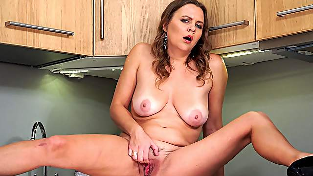 Seductive wife finger fucks pussy in solo kitchen play
